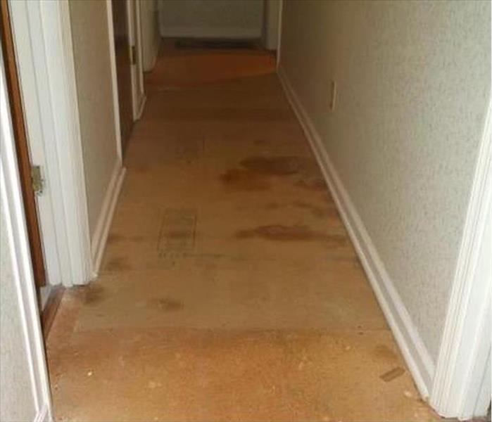 Storm Water Damages Morgantown Home Hallway Before